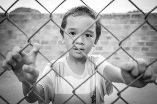 Fenced Portrait by Graeme Heckels Hoi An Travel Photography, Vietnam