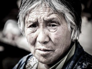 Portrait of a lady frowning in Bhumtang, Bhutan
