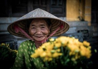 Portrait of Flower Lady by Graeme Heckels Hoi An Travel Photography, Vietnam