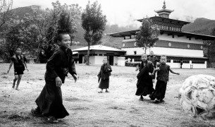 Black & White, Novice monks playing football in the grounds of a sacred temple in Bhutan.