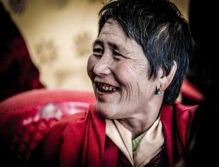Candid Portrait of a lady with red teeth, chewing bettel nut, in Bhutan