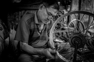 Bike Man by Graeme Heckels Saigon Street Photography, Vietnam