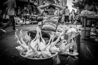 Chicken Man by Graeme Heckels Saigon Street Photography, Vietnam