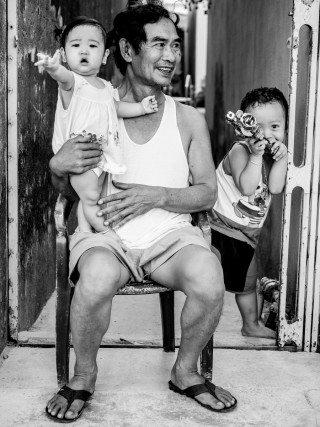 Father & Children by Graeme Heckels Saigon Street Photography, Vietnam
