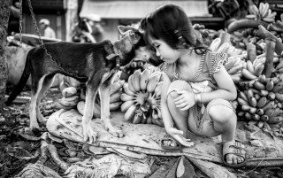 Kiss, Girl & her Dog by Graeme Heckels Saigon Street Photography, Vietnam