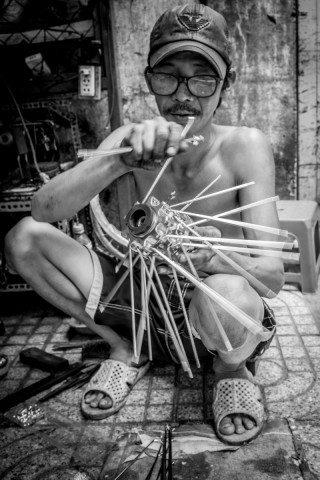 Spokes by Graeme Heckels Saigon Street Photography, Vietnam