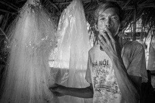 Smoking Fisherman by Graeme Heckels Quy Nhon Street & Travel Photography, Vietnam