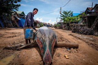 Shipwrecked in Siem Reap floating village by Graeme Heckels Travel Photography