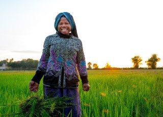 Portrait Happy farmer fireflies in Siem Reap by Graeme Heckels Travel Photography