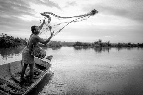 Fisherman casts net in Siem Reap by Graeme Heckels Travel Photography Cambodia