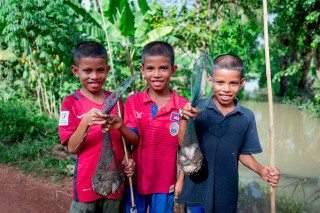 Portrait Three Frog Catchers in Siem Reap by Graeme Heckels Travel Photography