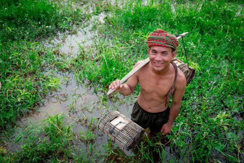 Portrait of a farmer in Siem Reap field by Graeme Heckels Travel Photography