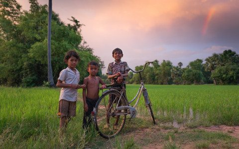 Children play on bike in Siem Reap countryside by Graeme Heckels Travel Photography