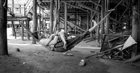 Mother & daughter play in hammock in Siem Reap by Graeme Heckels Travel Photography Cambodia