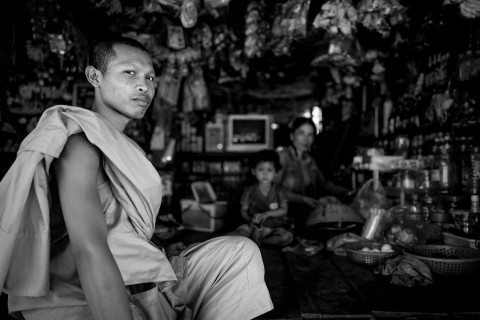 Curious monk at a shop in Siem Reap by Graeme Heckels Travel Photography Cambodia