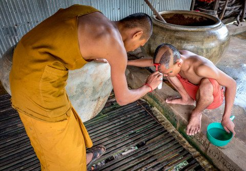 Monk head shaving ritual in Siem Reap by Graeme Heckels Travel Photography Cambodia