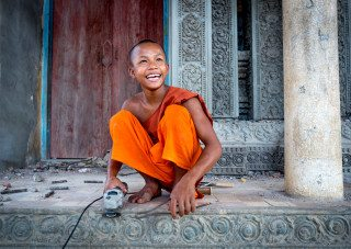 Portrait of a monk building temple in Siem Reap by Graeme Heckels Travel Photography Cambodia