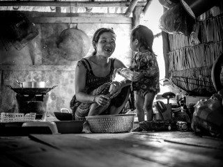 Portrait of mother & daughter in Siem Reap floating village by Graeme Heckels Travel Photography