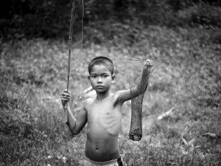 Portrait of a boy catching frogs in Siem Reap by Graeme Heckels Travel Photography