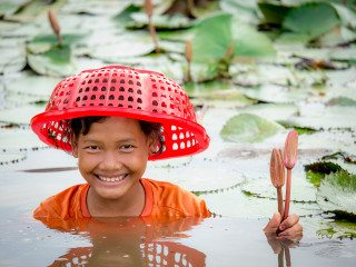 Portrait of a Girl in waterlily pond by Graeme Heckels Travel Photography