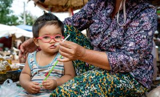 Cute Girl in Pink Glasses in Siem Reap Market Graeme Heckels Travel Photography