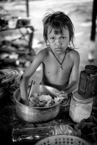 Girl eating Rice for breakfast in Siem Reap Countryside by Graeme Heckels Travel Photography