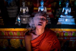Monk smoking in Siem Reap Temple by Graeme Heckels Travel Photography