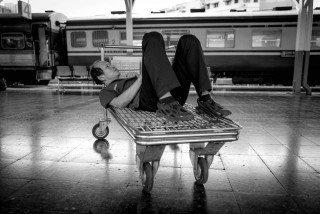 Nap time at Hua Lumphong Station in Bangkok by Graeme Heckels Travel & Street Photography