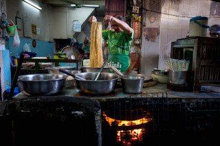 Noodle Maker in Bangkok by Graeme Heckels Travel & Street Photography