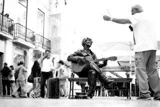 John Lennon Sings in Lisbon by Graeme Heckels Travel & Street Photography