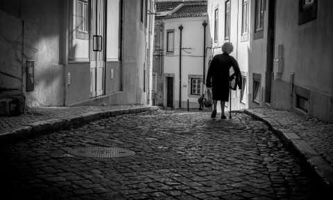 Old Lady Strolling in Lisbon by Graeme Heckels Travel & Street Photography