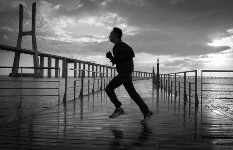 Run near Vasco Da Gama Bridge Lisbon by Graeme Heckels Travel & Street Photography