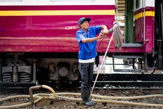 Cleaner at Hua Lumphong Station Bangkok by Graeme Heckels Street & Travel Photography