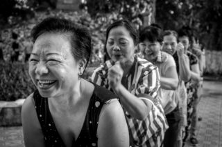 Black and White photo by Graeme Heckels Hanoi Street Photography Smile Train_Massage a Friend