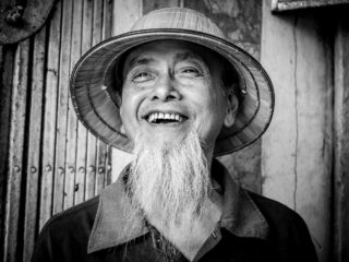 Black and White photo by Graeme Heckels Hanoi Street Photography Uncle