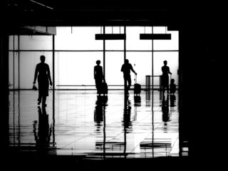 Black and White photo by Graeme Heckels Hanoi Street Photography Departures Airport Crew Airline