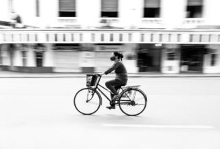 Black and White photo by Graeme Heckels Hanoi Street Photography Peddle Bicycle Panning