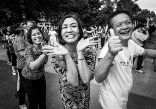 Black and White photo by Graeme Heckels Hanoi Street Photography Happy Yoga Portrait
