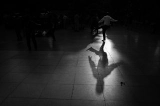 Black and White photo by Graeme Heckels Hanoi Street Photography Shadow Dancer