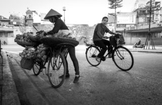 Black and White photo by Graeme Heckels Hanoi Street Photography Hot Wheels Bicycle Motorbike Vietnam