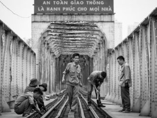 Black and White photo by Graeme Heckels Hanoi Street Photography Railway Workers