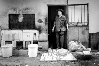 Black and White photo by Graeme Heckels Hanoi Street Photography Cowboy