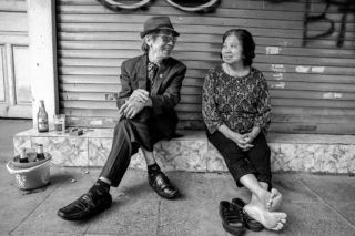Black and White photo by Graeme Heckels Hanoi Street Photography Loving Couple