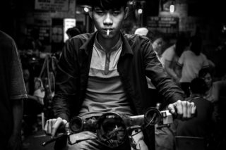Black and White photo by Graeme Heckels Hanoi Street Photography Tough Guy Portrait