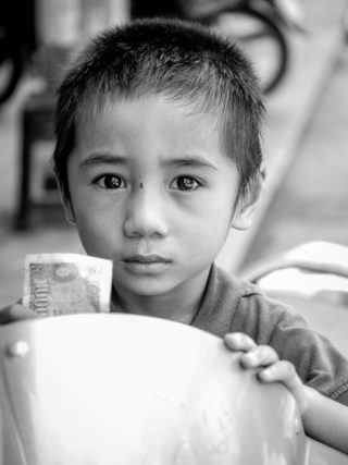 Black and White photo by Graeme Heckels Hanoi Street Photography Innocence