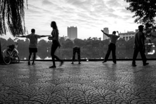 Black and White photo by Graeme Heckels Hanoi Street Photography Morning Exercise