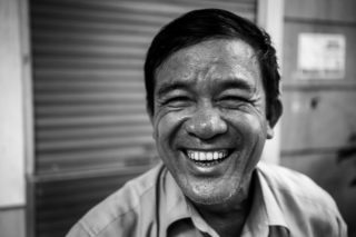 Black and White photo by Graeme Heckels Hanoi Street Photography Mr Happy