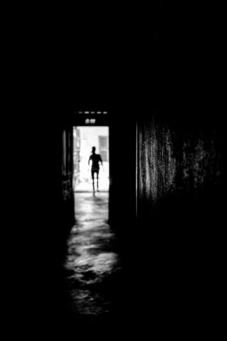 Black and White photo by Graeme Heckels Hanoi Street Photography Ghostly Silhouette