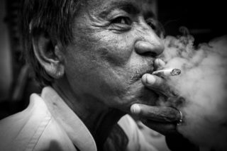 Black and White photo by Graeme Heckels Hanoi Street Photography Pipe Smoker