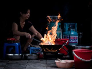 Black and White photo by Graeme Heckels Hanoi Street Photography Flash in The Pan Food Flames